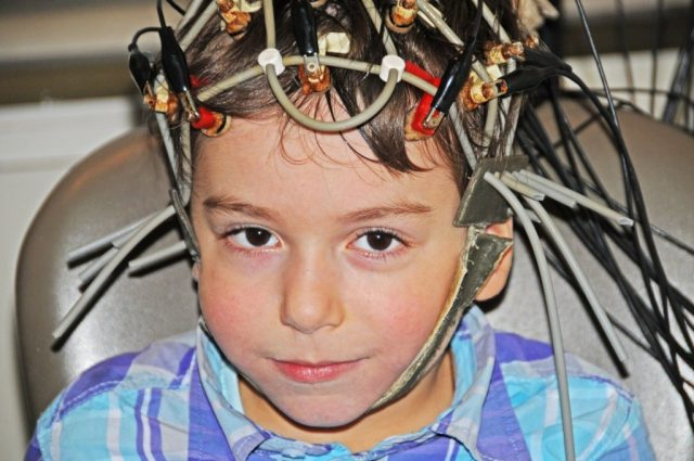 Child with sensors on his head